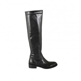 Woman's kneehigh boot in black leather and elastic material heel 3