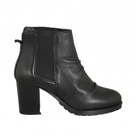 Woman's ankle boot in black leather with elastic bands heel 7 - Available sizes:  32, 33, 34, 42, 43, 44, 45