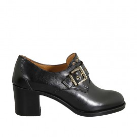 Woman's highfronted shoe with buckle and studs in black leather heel 6