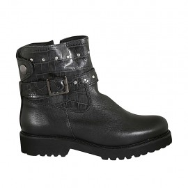 Woman's ankle boot with zipper, studs, snap button and buckle in black leather and printed leather heel 3